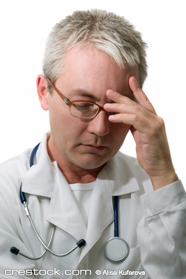 Concentrated doctor in glasses with stethoscope.