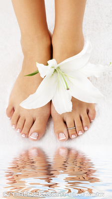 beautiful lady feet with madonna lily in spa